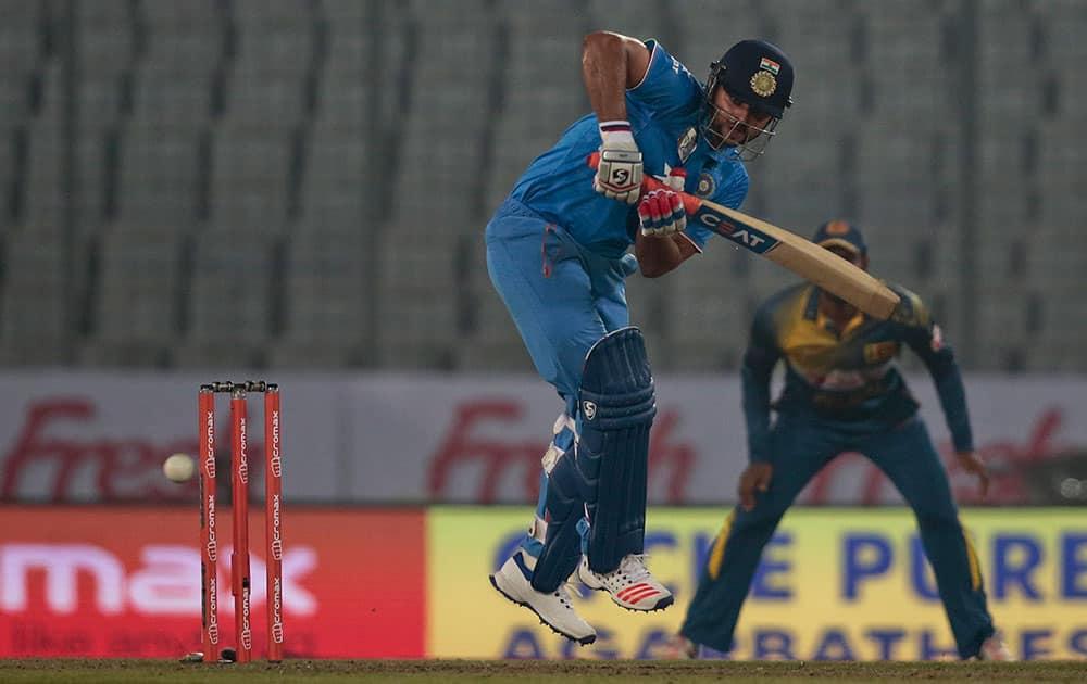 Suresh Raina plays a shot during the Asia Cup Twenty20 international cricket match against Sri Lanka in Dhaka, Bangladesh.