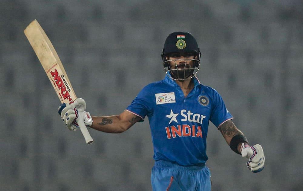Virat Kohli acknowledges the crowd after scoring fifty runs during the Asia Cup Twenty20 international cricket match against Sri Lanka in Dhaka, Bangladesh.