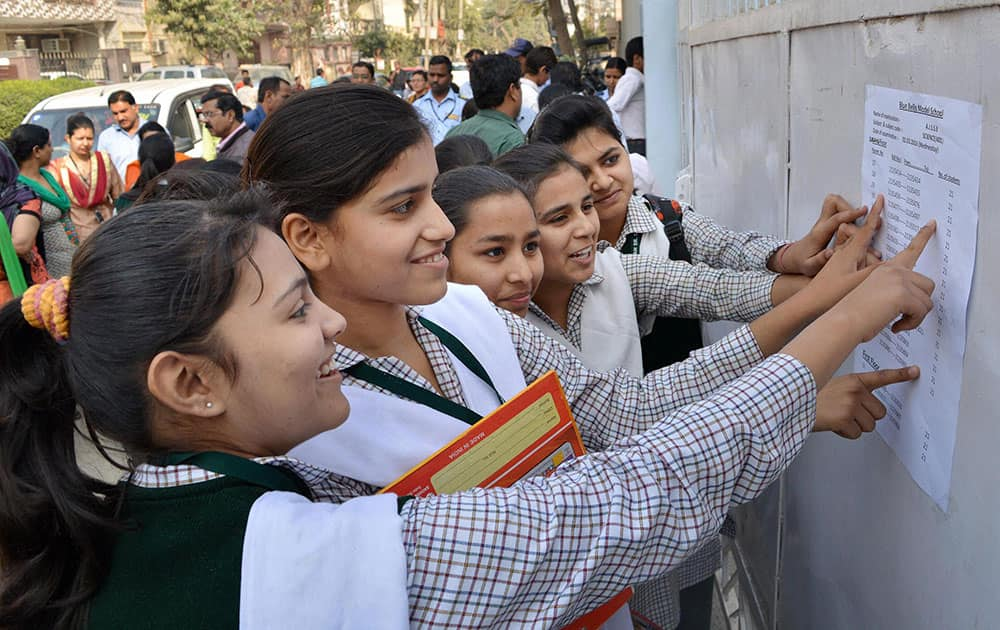 Students search for their roll numbers in the seat allocation sheet before taking the class 10 CBSE board exam, in Gurgaon.