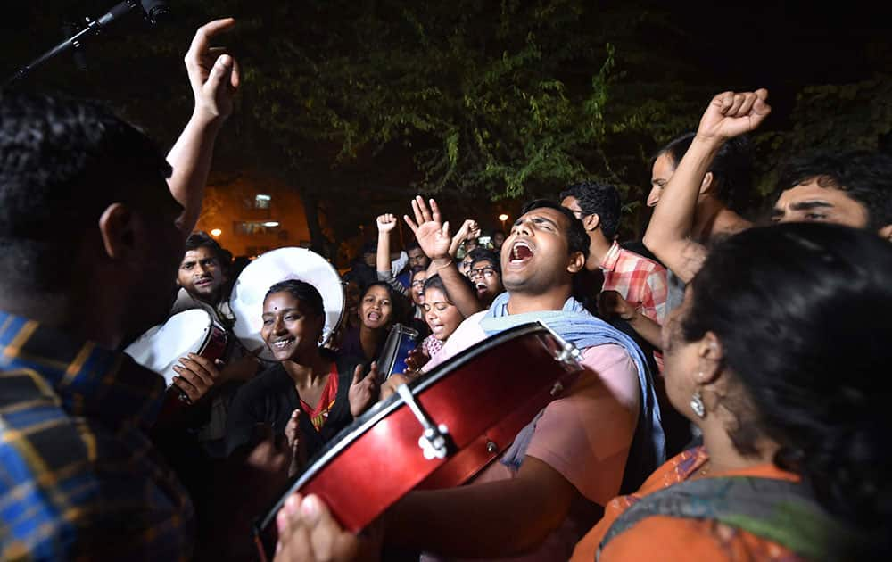 Jawaharlal Nehru University students celebrate after Delhi High Court granted bail to JNUSU president Kanhaiya Kumar at the JNU campus in New Delhi.