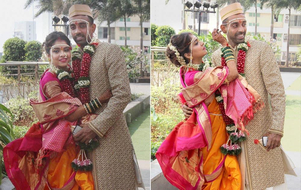 Indian cricketer Dhawal Kulkarni and his wife Shraddha Kharpude during their wedding in Mumbai.
