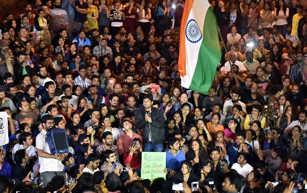 JNUSU President Kanhaiya Kumar addresses students after reaching at the JNU campus upon his release on bail, in New Delhi.