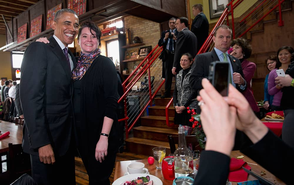 President Barack Obama poses for photos with Erin Bode at Engine Company No 3 in Milwaukee.