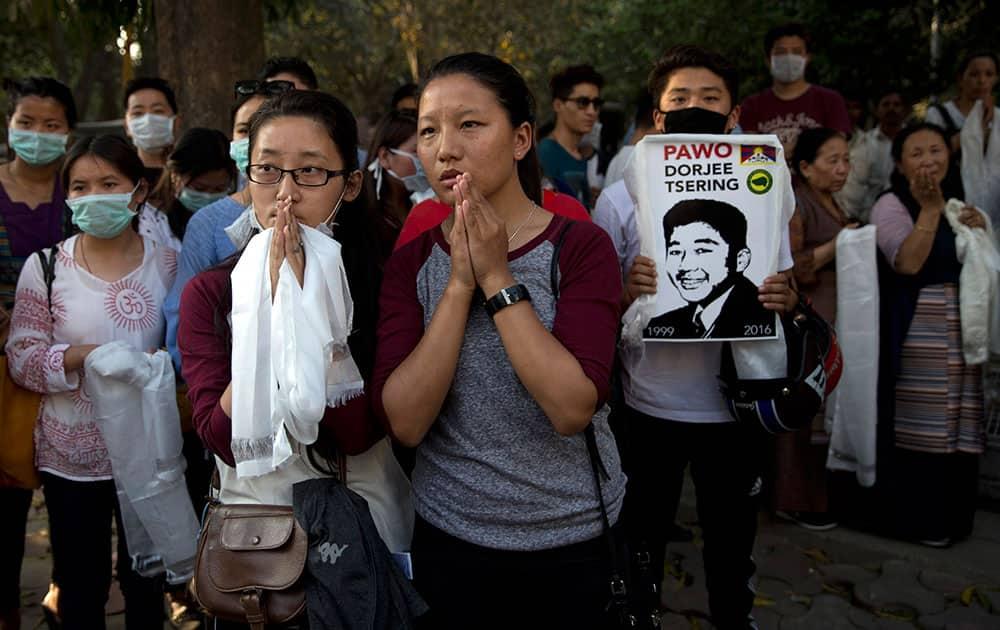 Exile Tibetans pay their respect outside the hospital where Dorje Tsering's body was kept, in New Delhi.