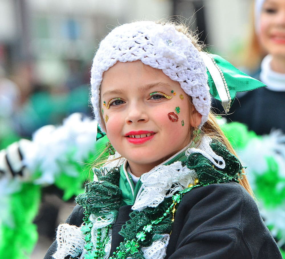 Kaitlyn Hess, 9, shows off her Irish colors during the third annual St. Patrick's Parade in Pittston, Pa.