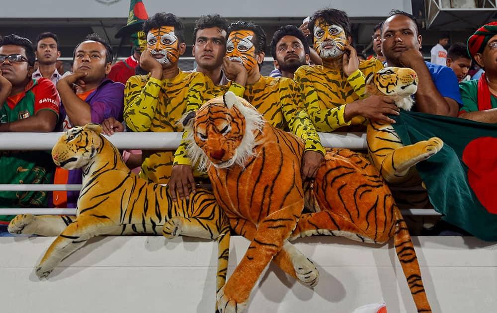 Bangladeshi spectators watch after India won the Asia Cup Twenty20 international cricket final match against Bangladesh in Dhaka, Bangladesh.