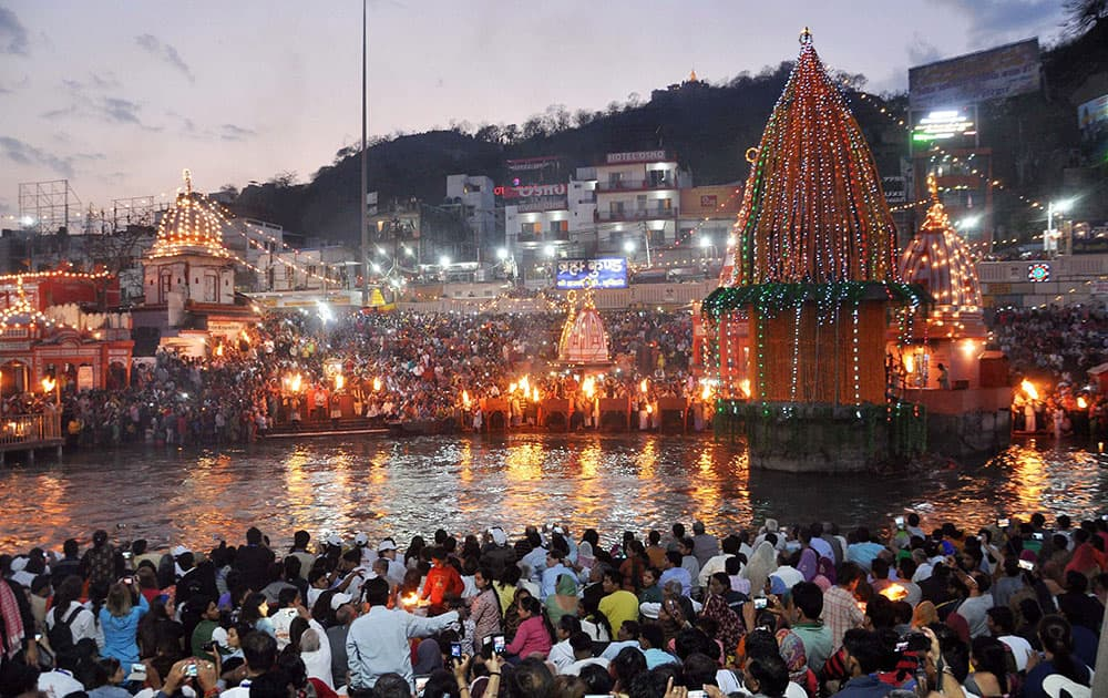 Devotees take part in Ganga aarti on the eve of Mahashivratri at Har Ki Pauri in Haridwar.