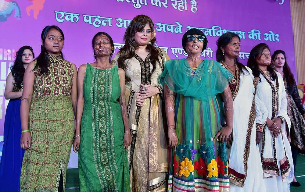 Acid attack victim women walk the ramp with TV actress Amita Nangia during a fashion show organised by an NGO Prerna to mark the International Womens Day, in Bhopal.