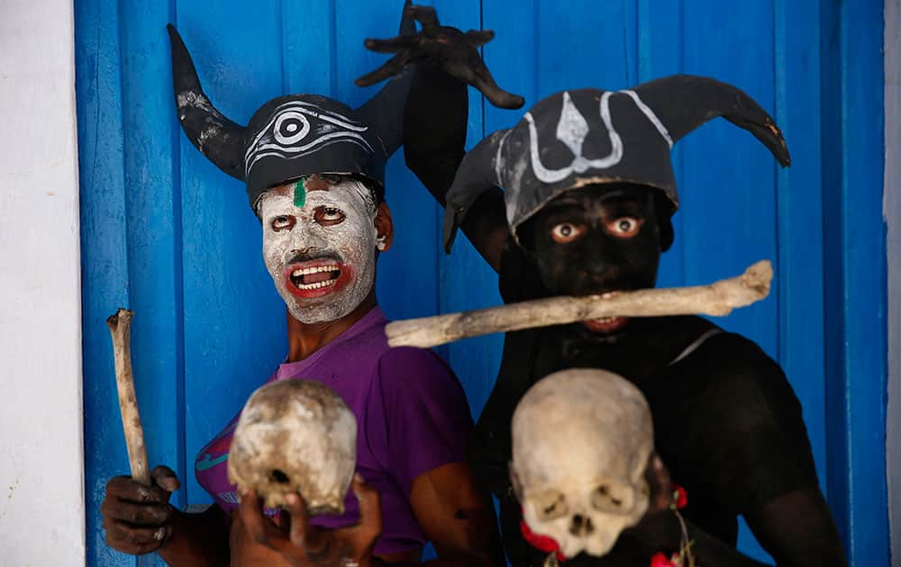 Hindu devotees dressed as demons pose for pictures as they participate in a procession on occasion of Mahashivratri festival in Allahabad,