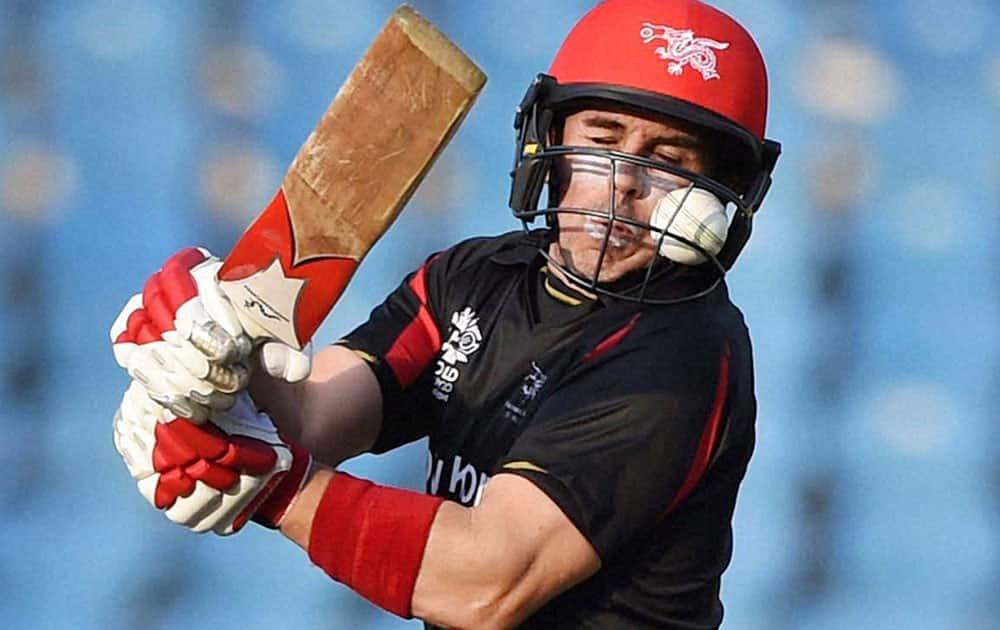 A ball gets stuck in the helmet of Hong Kong batsman Ryan Campbell during the ICC World Twenty20 2016 cricket tournament against Zimbabwe at the Vidarbha Cricket Association Stadium in Nagpur.