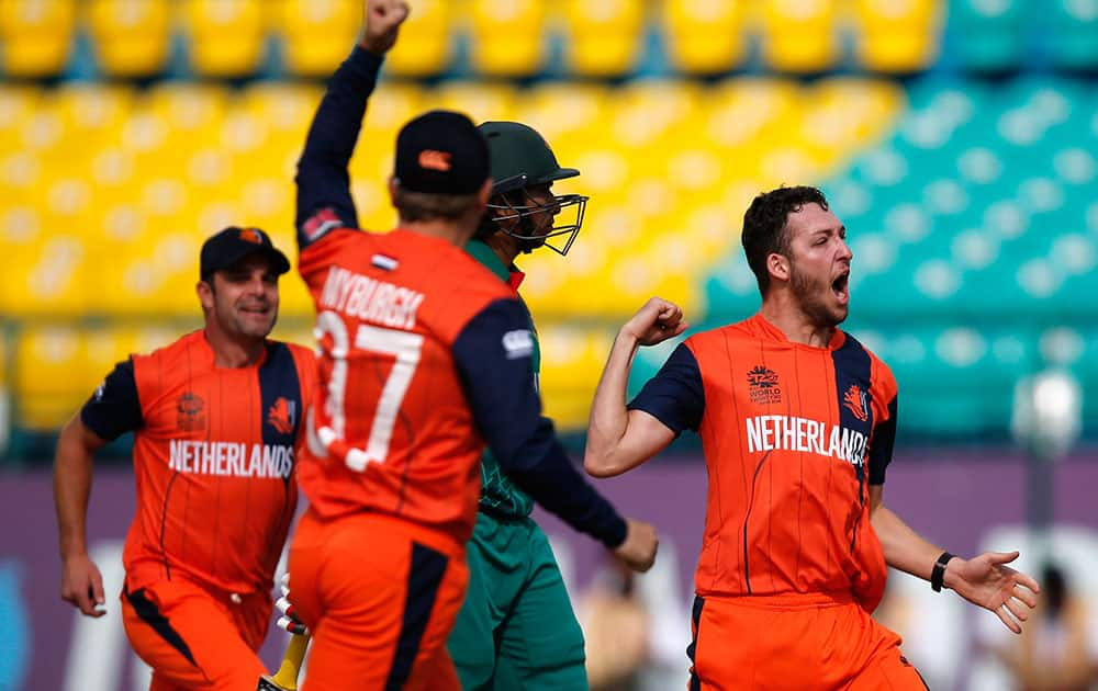 Paul van Meekeren of the Netherlands celebrates the dismissal of Bangladesh's Soumya Sarkar during the ICC World Twenty20 2016 cricket tournament at the Himachal Pradesh Cricket Association (HPCA) stadium in Dharmsala.