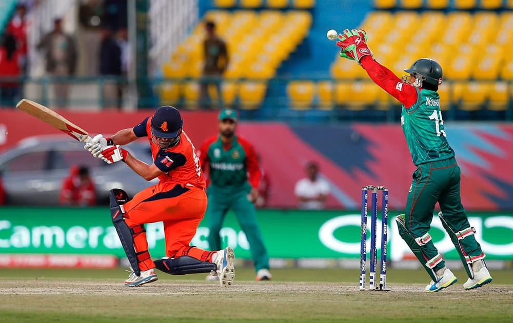 Bangladesh's Mustafizur Rahman tries to field a ball from Peter Borren of the Netherlands during the ICC World Twenty20 2016 cricket tournament at the Himachal Pradesh Cricket Association (HPCA) stadium in Dharmsala.