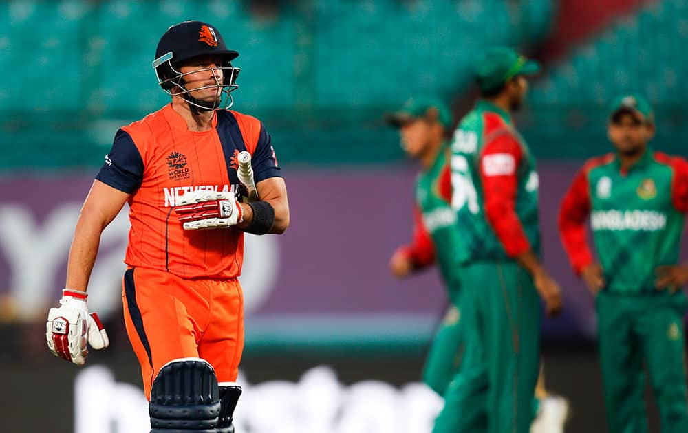 Roelof van der Merwe of the Netherlands walks back after his dismissal during the ICC World Twenty20 2016 cricket tournament against Bangladesh at the Himachal Pradesh Cricket Association (HPCA) stadium in Dharmsala.