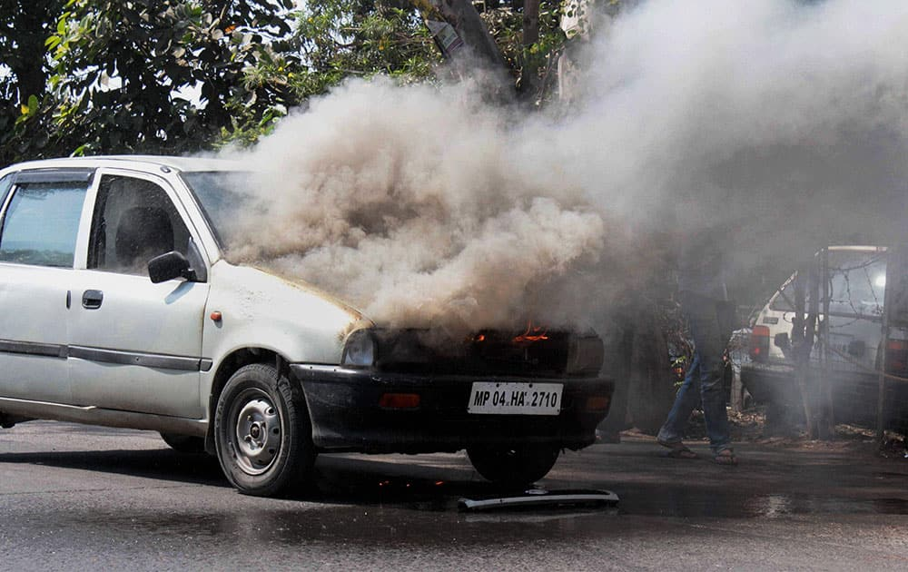 Smoke billows out after a moving car caught fire in Bhopal.