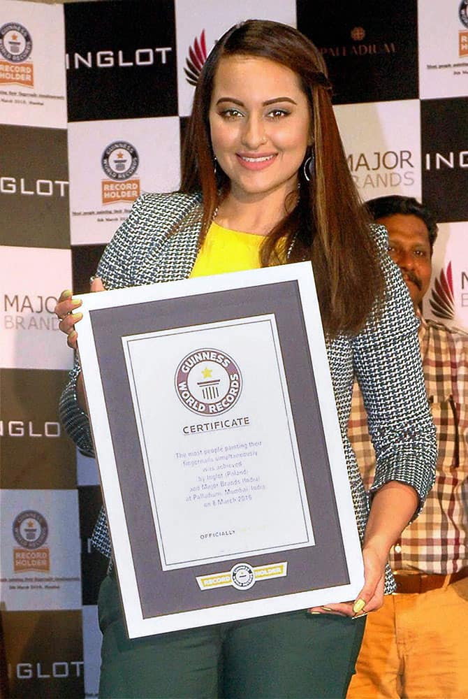 """Actress Sonakshi Sinha receiving the Guinness World Record title of """"Most people painting their fingernails simultaneously"""" on behalf of a womens brigade at Poland-based cosmetic brand Inglot s Womens Day event in Mumbai."""