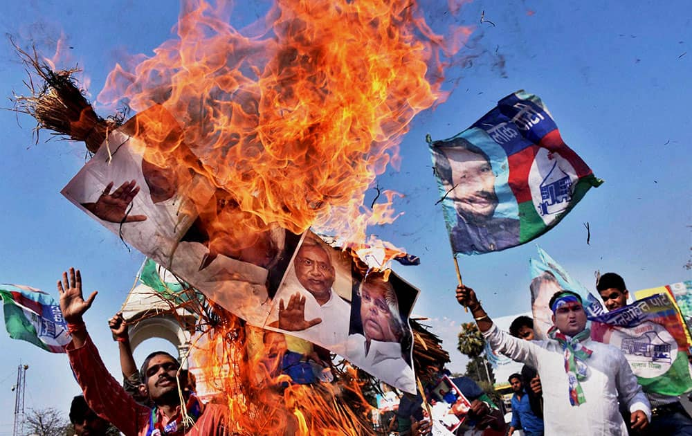 Lok Janshakti party activists burn the effigy of Bihar Chief Minister Nitish Kumar and RJD Chief Lalu Prasad during a protest against poor law & order in Patna.