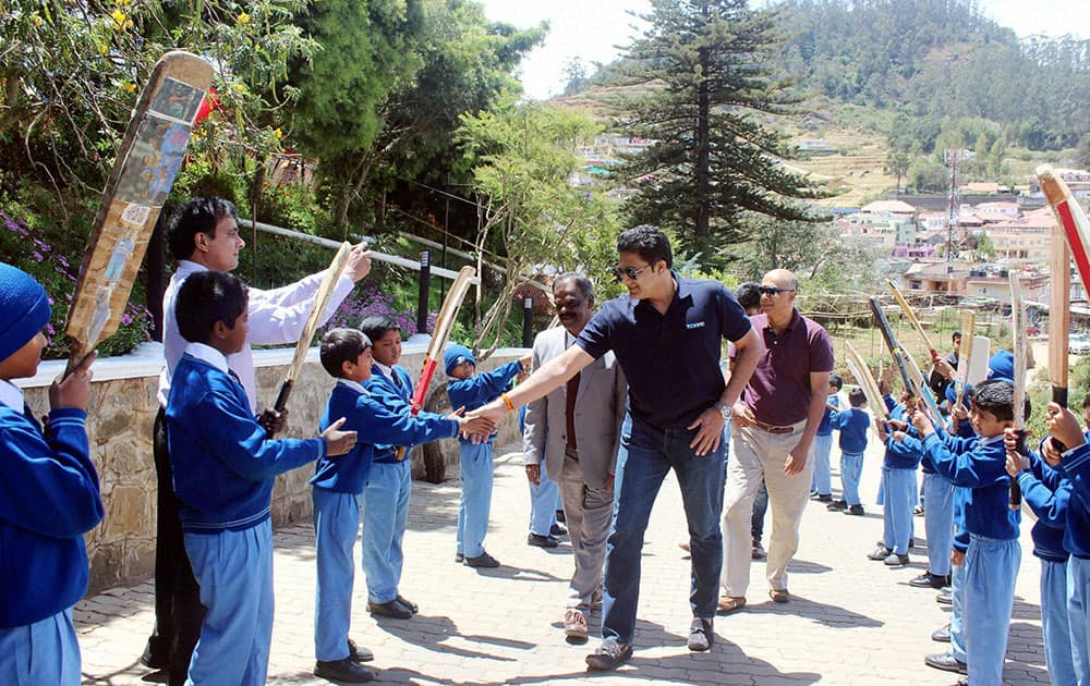 Former cricketer Anil Kumble interacts with the children of a city school in Ooty