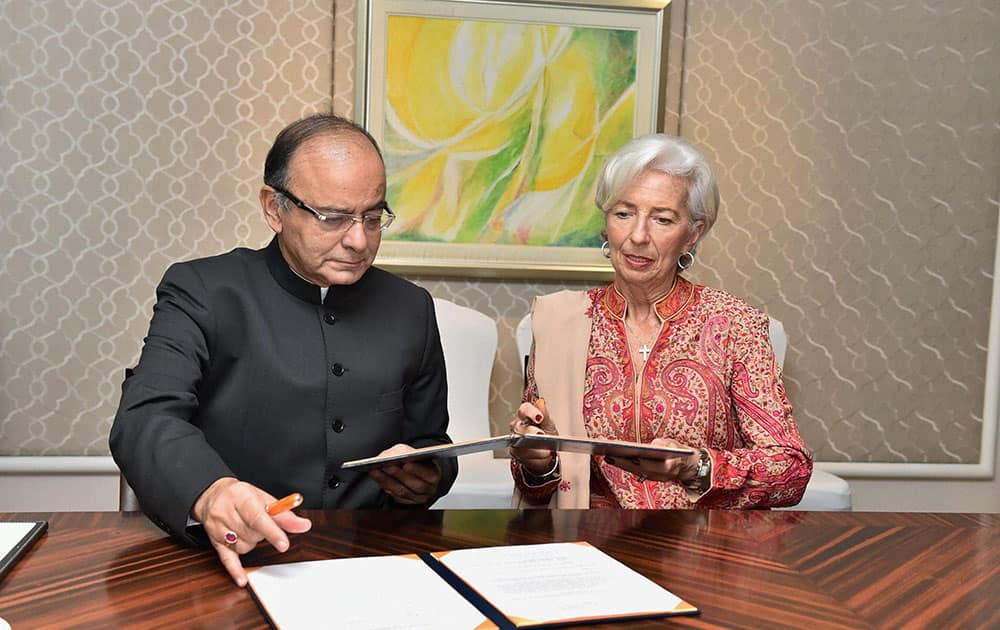 Finance Minister Arun Jaitley with International Monetary Fund Managing Director Christine Lagarde signing an MoU on the sidelines of the conference on Advancing Asia : Investing for the Future in New Delhi.