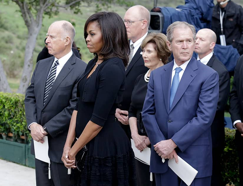 California Gov. Jerry Brown, first lady Michelle Obama and former President George W. Bush, watch during the graveside service for Nancy Reagan at the Ronald Reagan Presidential Library, in Simi Valley, Calif.