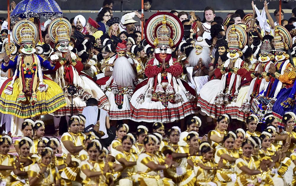 Artistes from Kerala perform during the opening day of the three-day long World Culture Festival on the banks of Yamuna River in New Delhi.