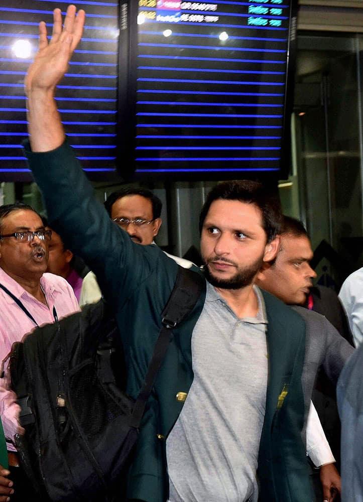 Pakistani cricket captain Shahid Afridi waves upon his teams arrival at NSCBI Airport for the upcoming T 20 World Cup in Kolkata.