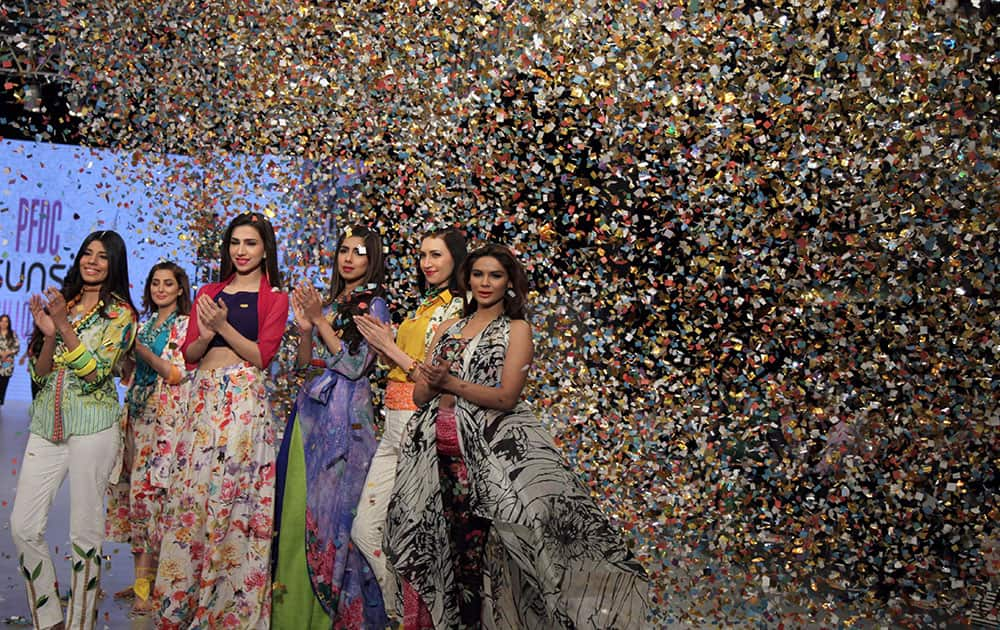 Model present creations by fashion brand Gul Ahmed during Fashion Week by the Pakistan Fashion Design Council in Lahore.