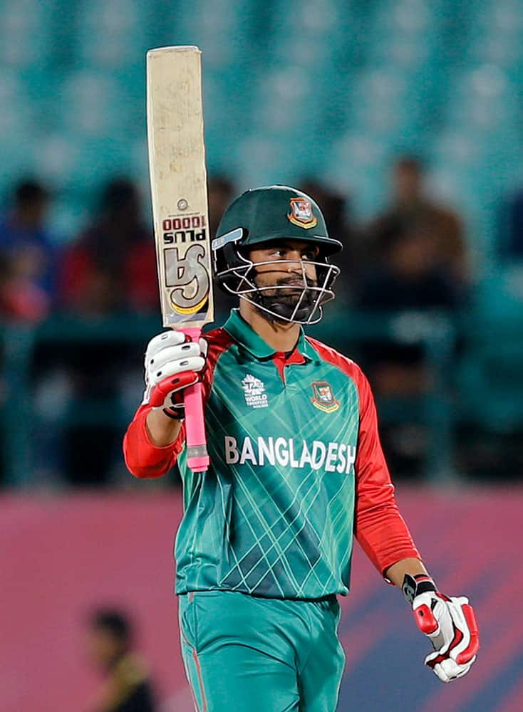Bangladesh's Tamim Iqbal acknowledges his fifty runs during the ICC World Twenty20 2016 cricket tournament against Oman at the Himachal Pradesh Cricket Association (HPCA) stadium in Dharamsala.