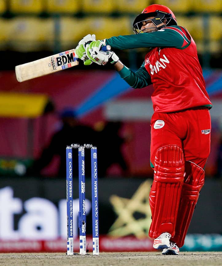 Oman's Aamir Kaleem plays a shot during the ICC World Twenty20 2016 cricket tournament against Bangladesh at the Himachal Pradesh Cricket Association (HPCA) stadium in Dharamsala.