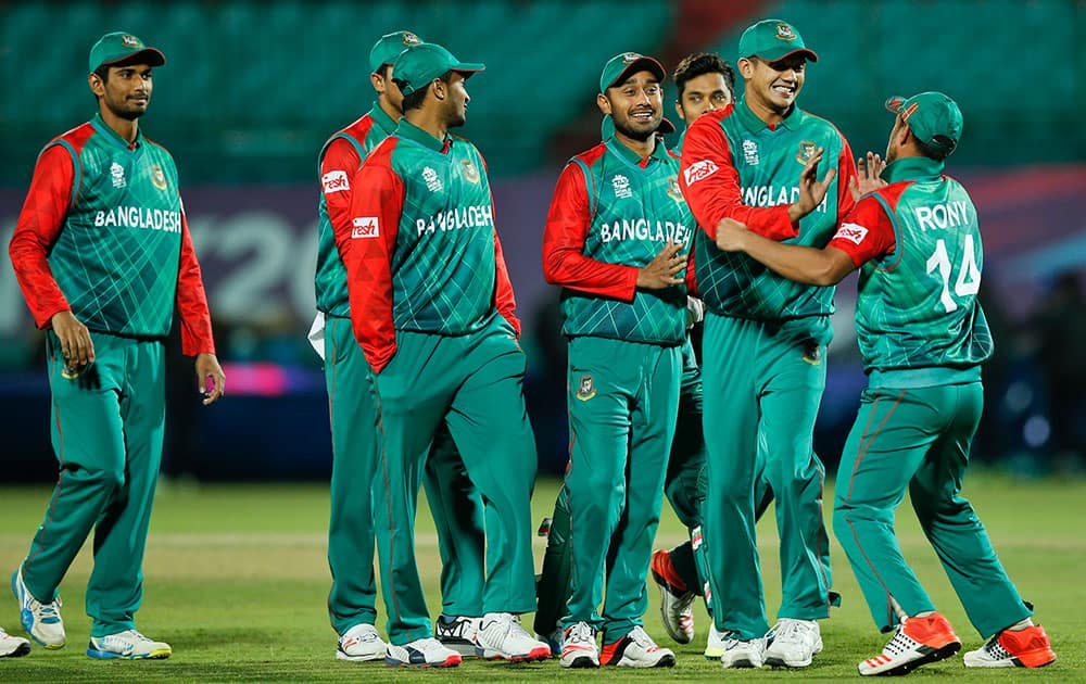 Bangladesh'players celebrate after they defeated Oman in the ICC World Twenty20 2016 cricket tournament at the Himachal Pradesh Cricket Association (HPCA) stadium in Dharamsala.
