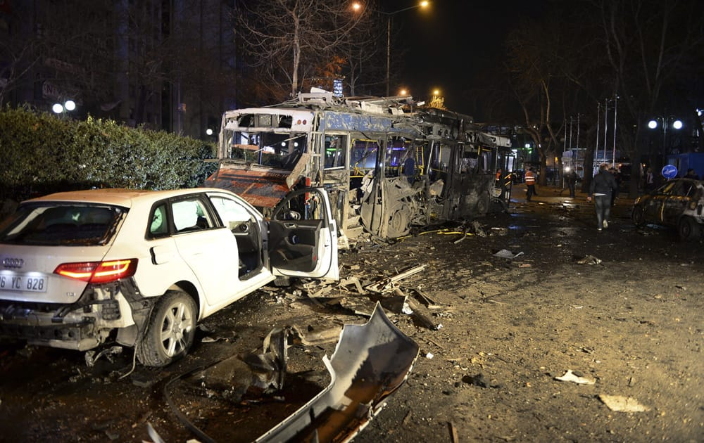 Damaged vehicles are seen at the scene of an explosion in Ankara. The explosion is believed to have been caused by a car bomb that went off close to bus stops.