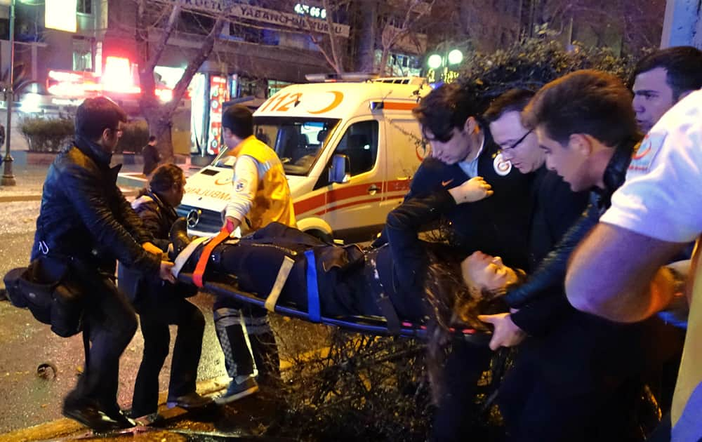 Medics carry an injured at the explosion site in the busy center of Turkish capital, Ankara