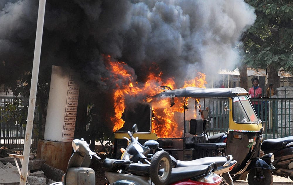 An autorickshaw burns in a stray violence by the BJP workers during a bandh called over the murder of a party leader, in Mysuru.