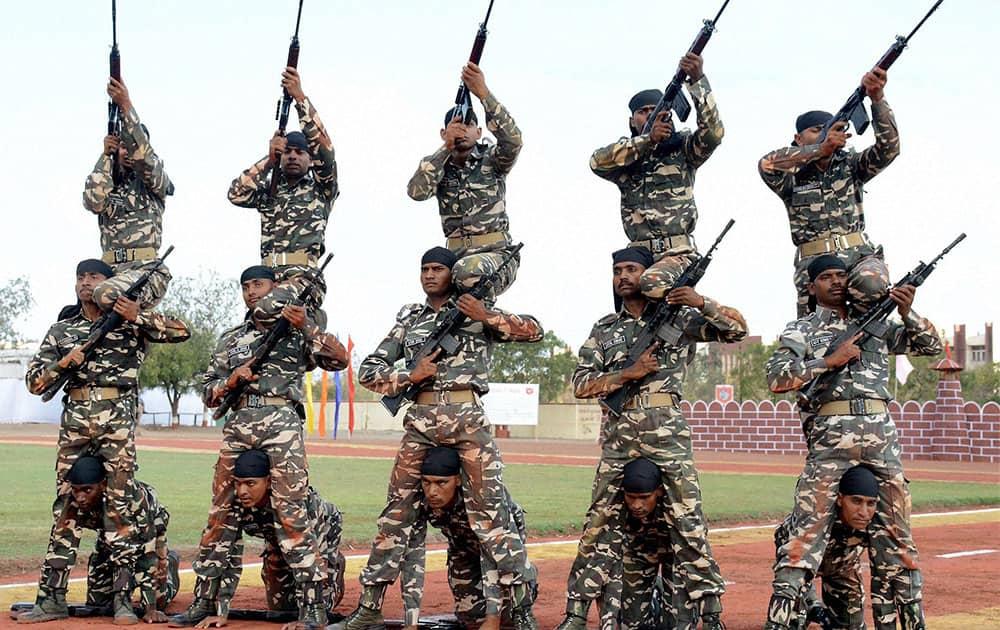 Armed guards of Sema Suraksha Bal (SSB) perform during a passing out parade in Jamnagar.
