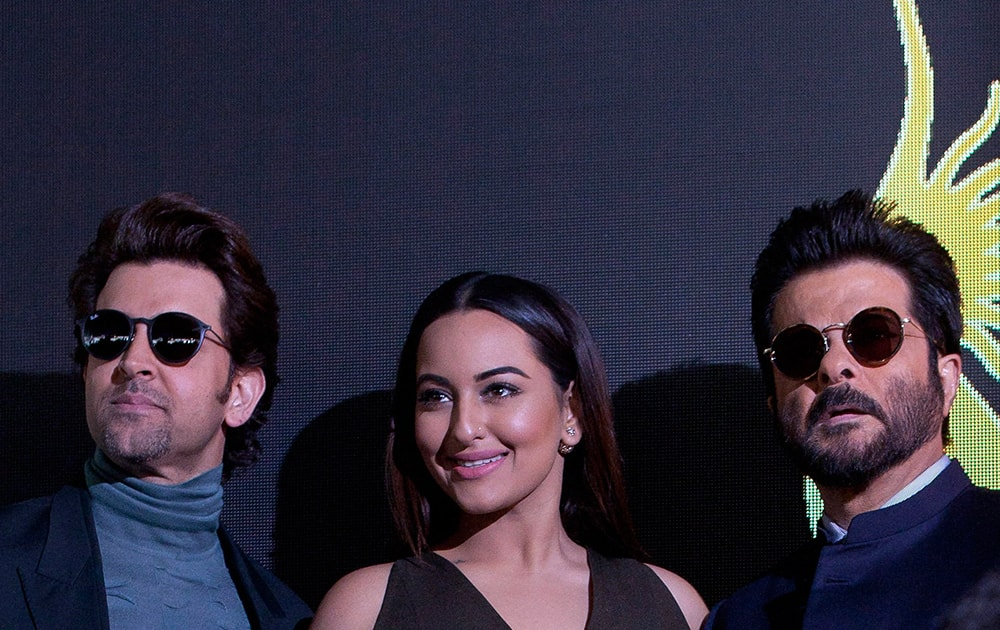 Bollywood actors Hrithik Roshan, left, Sonakshi Sinha, centre and Anil Kapoor, right, pose for photographers before the press conference for the 17º Edition of IIFA Weekend & Awards in Madrid, Spain.