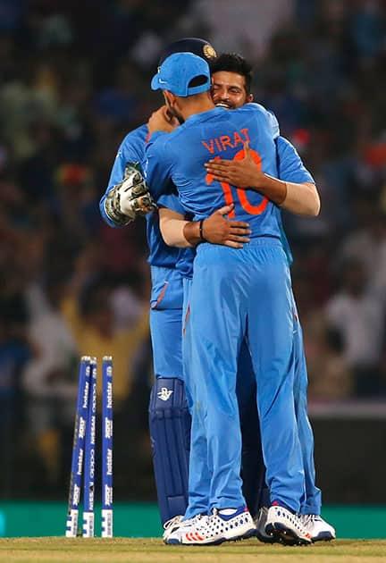Suresh Raina celebrates the wicket of New Zealand's Kane Williamson during the ICC World Twenty20 2016 cricket match at the Vidarbha Cricket Association stadium in Nagpur.