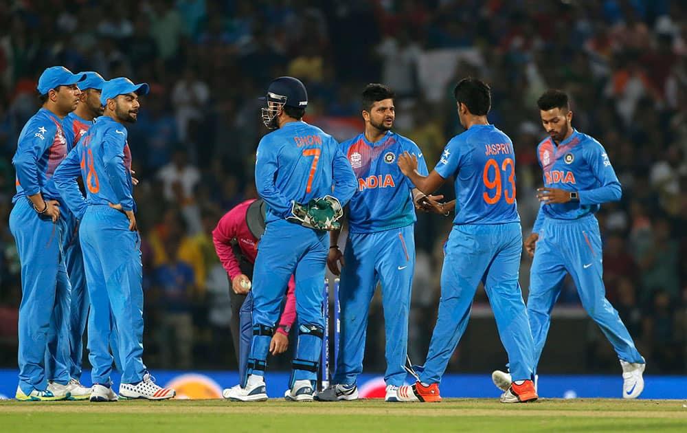 Suresh Raina celebrates after running out New Zealand's Ross Taylor during the ICC World Twenty20 2016 cricket match at the Vidarbha Cricket Association stadium in Nagpur.
