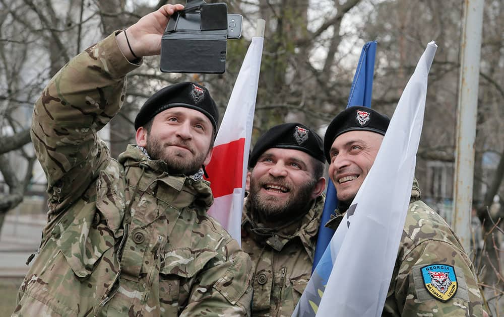 Officers of the Georgian National Legion volunteer battalion make a selfie prior to their departure to the area of the war conflict in Ukraines east, in Kiev, Ukraine.