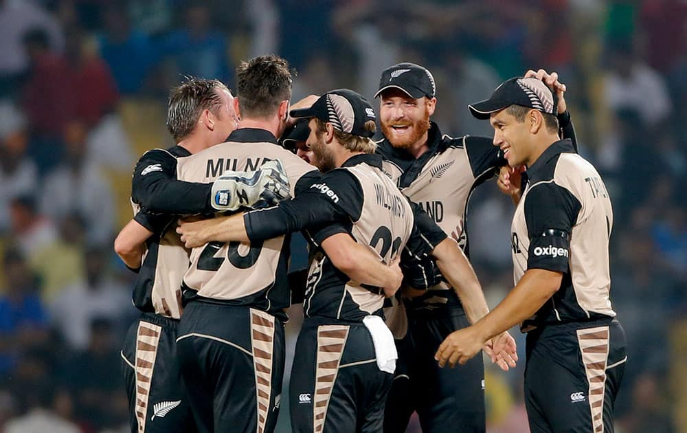 New Zealand players celebrate after defeating India by 47 runs during the ICC World Twenty20 2016 cricket match at the Vidarbha Cricket Association stadium in Nagpur.