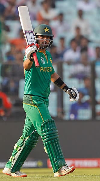 Pakistan's Ahmed Shehzad acknowledges scoring fifty runs during their match against Bangladesh in the ICC World Twenty20 2016 cricket in Kolkata.