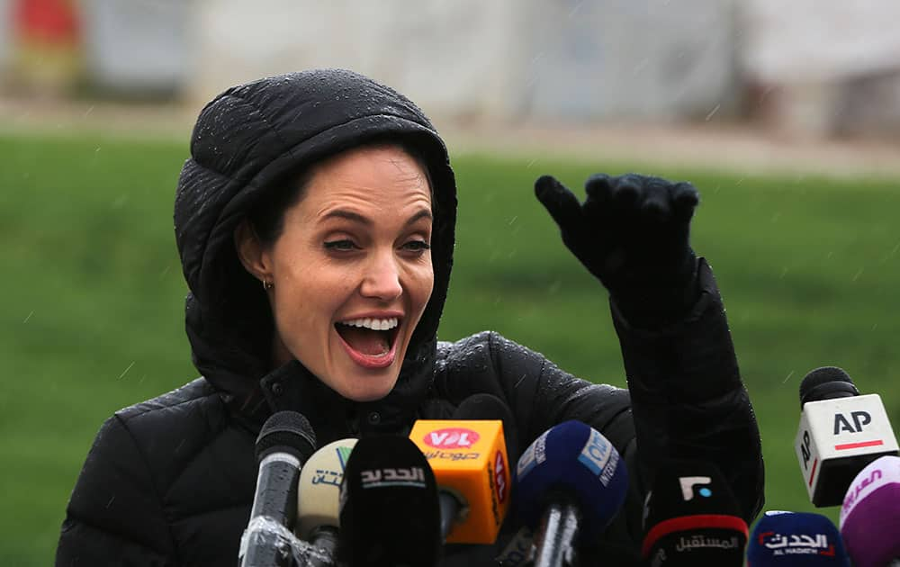 U.S. actress Angelina Jolie, Special Envoy of the United Nations High Commissioner for Refugees, waves to Syrian children during a press conference during her visit to a Syrian refugee camp, in the eastern city of Zahleh, Lebanon.