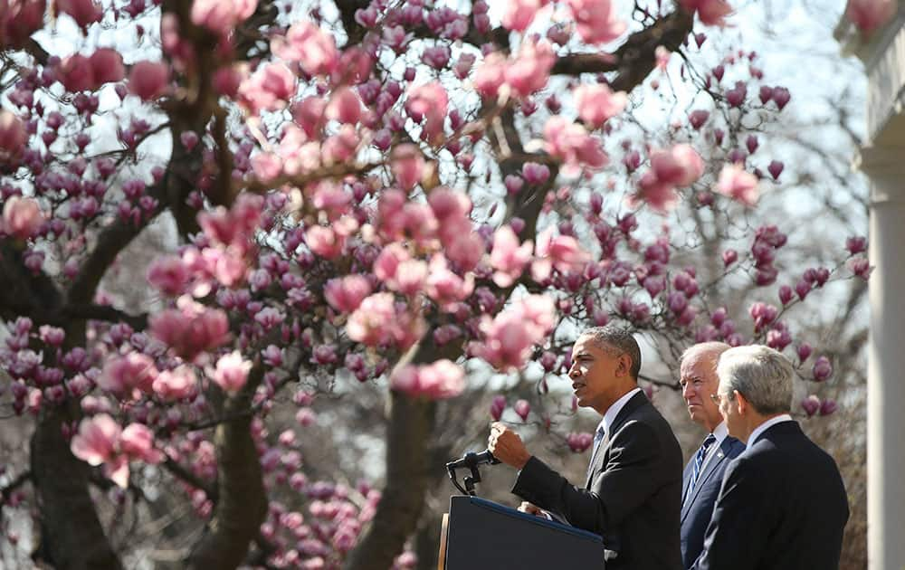 President Barack Obama and Vice President Joe Biden, center, introduce Federal appeals court judge Merrick Garland, right, as Obama's nominee for the Supreme Court during an announcement in the Rose Garden of the White House, in Washington.