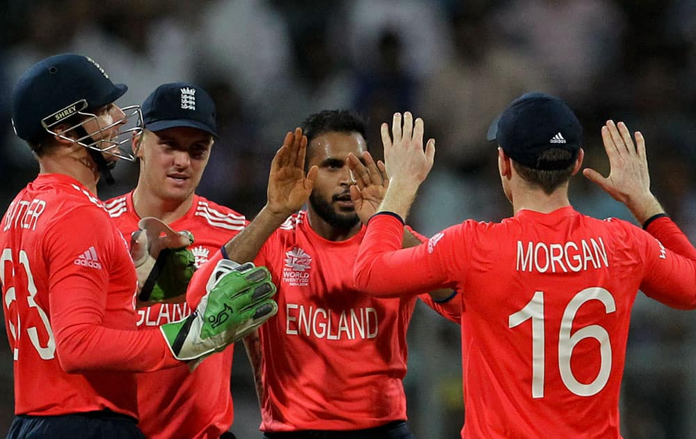 England players celebrate the wicket of West Indies' Marlon Samuels, during their ICC World Twenty20 2016 cricket match at the Wankhede stadium in Mumbai.
