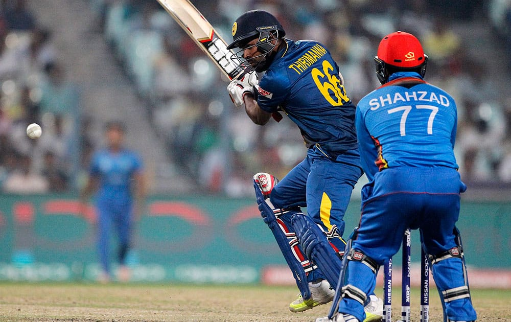 Sri Lanka's Lahiru Thirimanne plays a shot as Afghanistan's wicketkeeper Mohammad Shahzad watches during their match at the ICC World Twenty20 2016 cricket tournament in Kolkata.