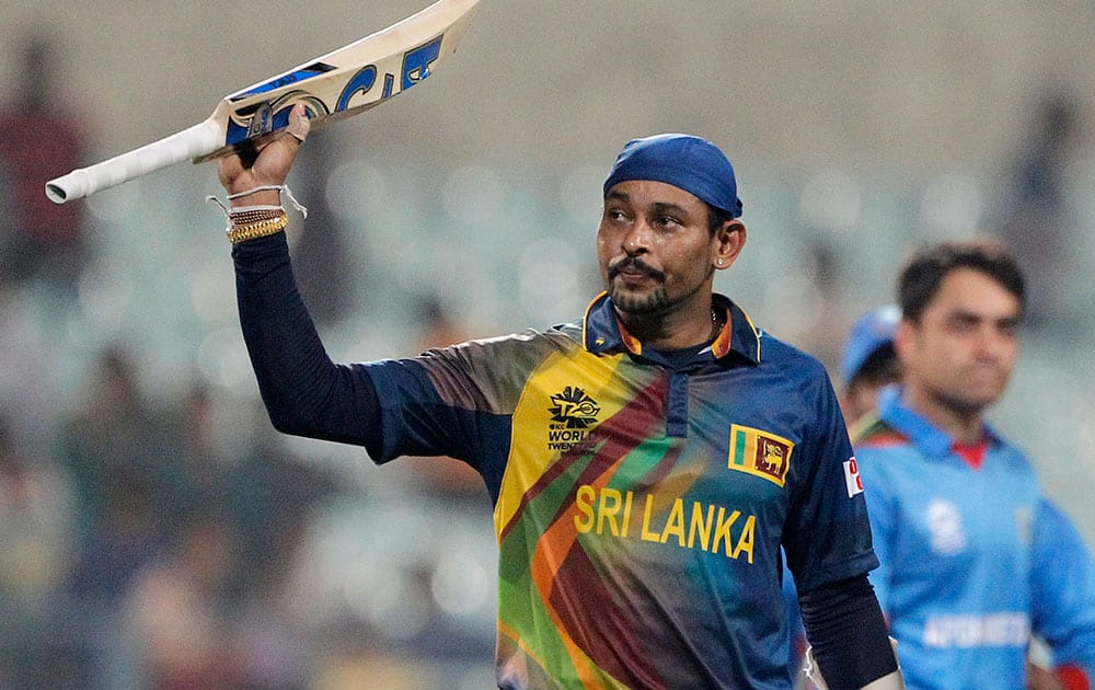 Sri Lanka's Tillakaratne Dilshan acknowledges the crowd after they defeated Afghanistan by six wickets in their ICC World Twenty20 2016 cricket match in Kolkata.