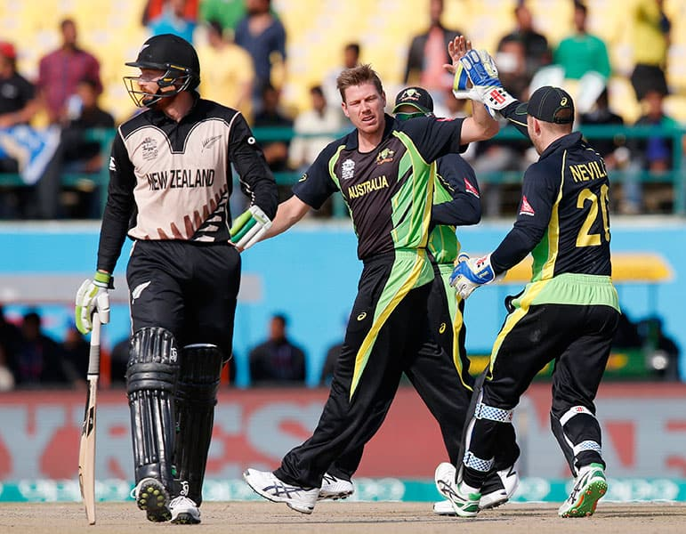 Australia's James Faulkner celebrates with teammate Peter Neville after dismissing New Zealand's Martin Guptill during their ICC World Twenty20 2016 cricket match at the Himachal Pradesh Cricket Association (HPCA) stadium in Dharamsala.