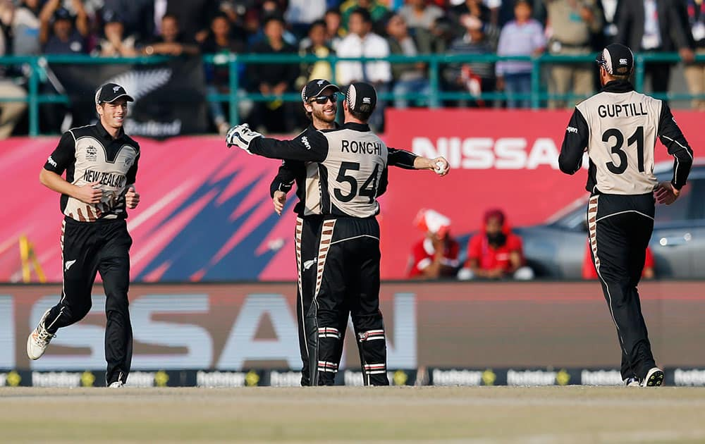 New Zealand player's celebrate the dismissal of Australia's Shane Watson during their ICC World Twenty20 2016 cricket match at the Himachal Pradesh Cricket Association (HPCA) stadium in Dharamsala.