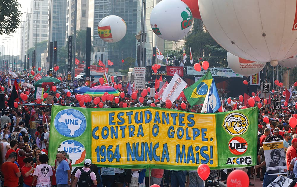 Demonstrators attend a rally in support of Brazil's President Dilma Rousseff and former President Luiz Inacio Lula da Silva, who was recently his successor's chief of staff, in Sao Paulo.