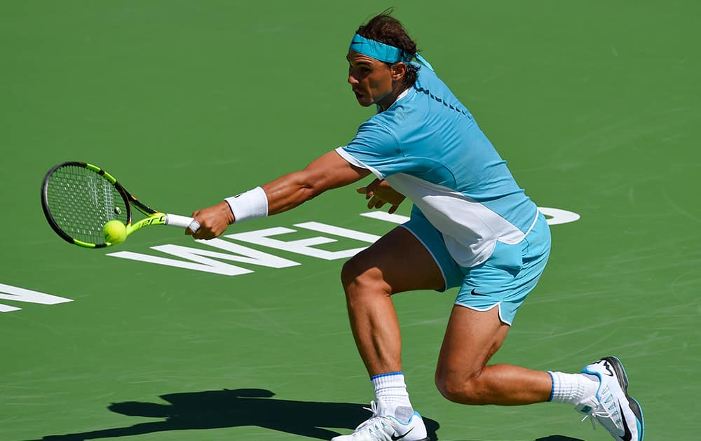 Rafael Nadal, of Spain, returns to Kei Nishikori, of Japan, during their quarterfinal match at the BNP Paribas Open tennis tournament.
