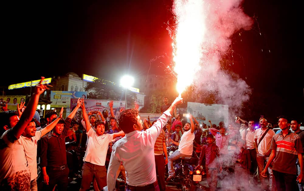 Indian supporters light crackers as they celebrate their team's victory in the ICC World Twenty20 2016 cricket match against Pakistan in Lucknow.