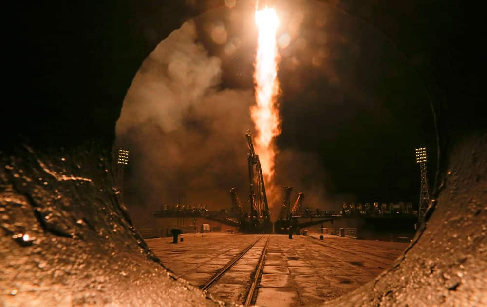 The Soyuz-FG rocket booster with Soyuz TMA-20M space ship carrying a new crew to the International Space Station, ISS, blasts off at the Russian leased Baikonur cosmodrome, Kazakhstan.